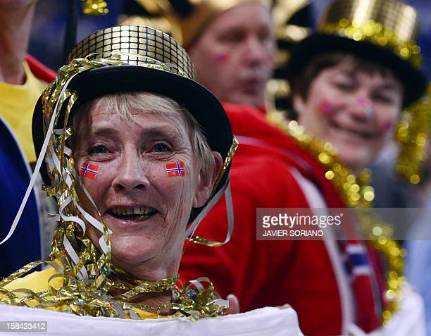 Norwegian supporters in costumes cheer their team prior to the 2012 EHF European Women's Handball Championship final match between Montenegro and...