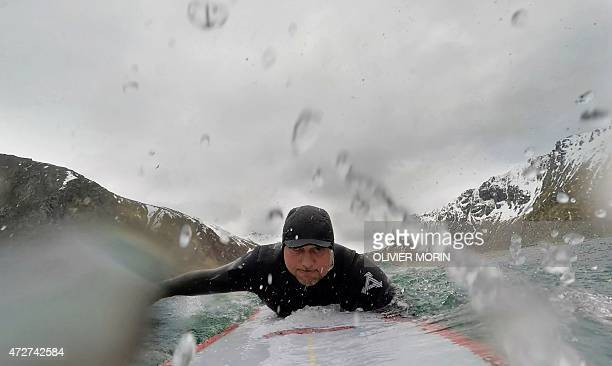 Norwegian surfboard shaper Kristian Breivik surfs in Unstad beach in the Lofoten Islands within the Arctic Circle on April 17 2015 Surfing in the...