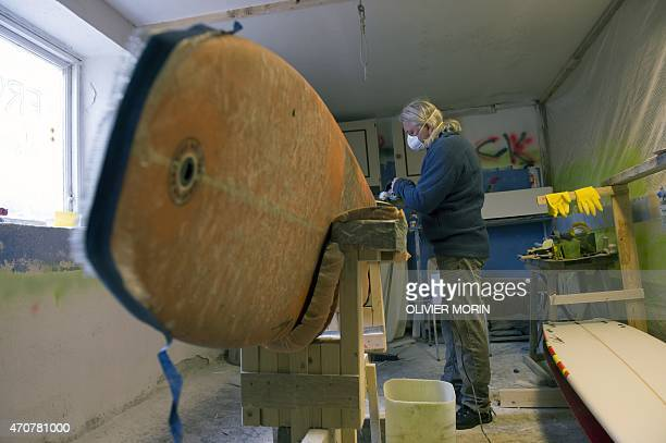 Norwegian surfboard shaper Kristian Breivik works on a surfboard in his workshop near Unstad in the Lofoten Islands within the Arctic Circle on April...