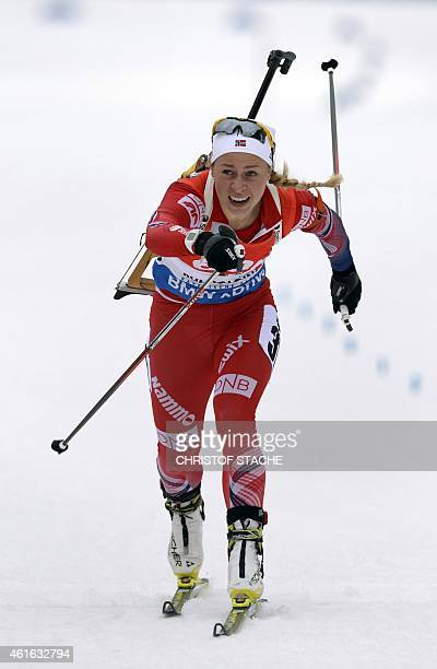 Norwegian Tiril Eckhoff passes the finish line after the women 75 kilometers sprint competition at the Biathlon World Cup on January 16 in Ruhpolding...