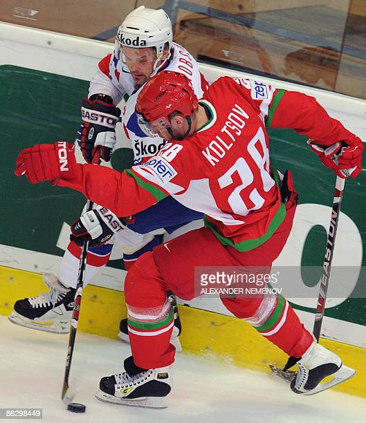Norwegian Tommy Jakobsen challenges Belarus Konstantin Koltsov during their Group F qualification round game at the 2009 IIHF International Ice...
