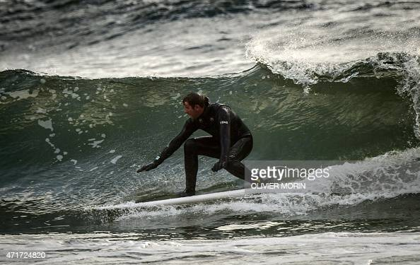 Norwegian Tommy Olsen surfs in Unstad in the Lofoten Islands within the Arctic Circle on April 18 2015 Surfing in the Lofoten Islands has started...