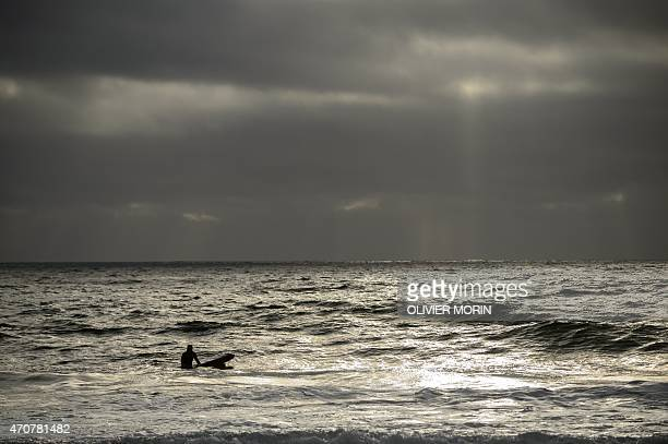 Norwegian Tommy Olsen waits for waves in Unstad in the Lofoten Islands within the Arctic Circle on April 18 2015 Surfing in the Lofoten Islands has...