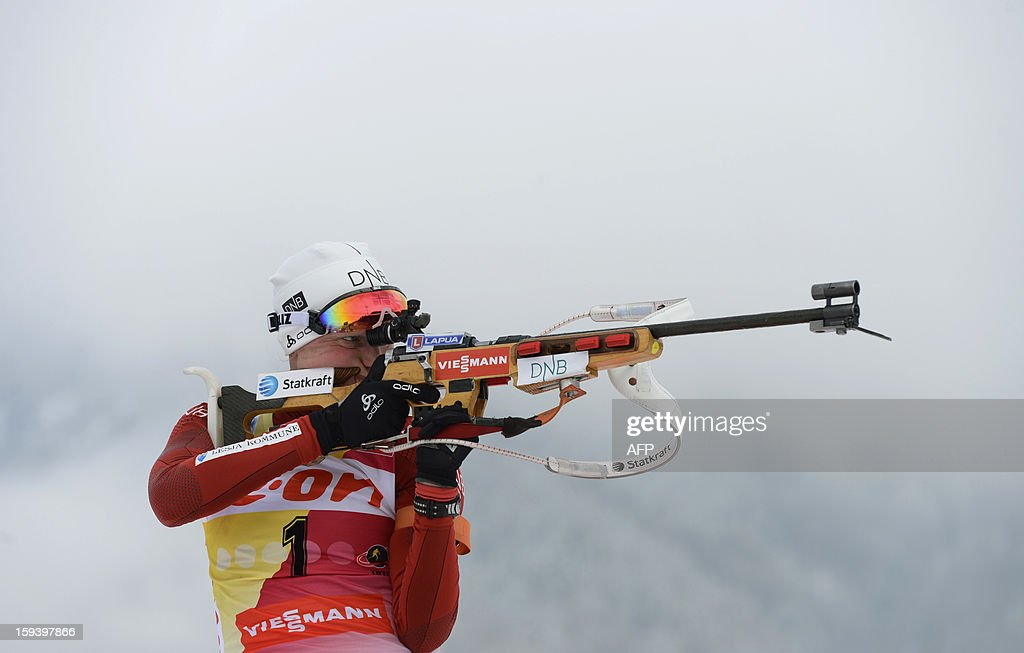 Norwegian Tora Berger shoots during the 12,5 km women Biathlon World Cup mass start competition on January 13, 2013, in Ruhpolding, southern Germany. Tora Berger won the competition, Belarus Darya Domracheva placed second and Russia's Olga Zaitseva placed third.