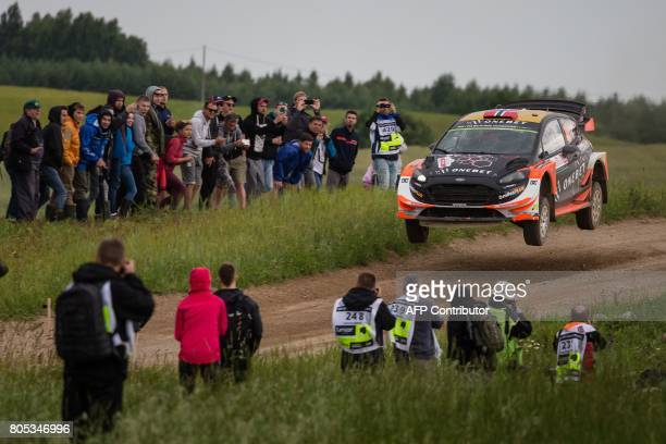 Norwegians Mads Ostberg and his codriver Ola Floene steer their Ford Fiesta WRC during special stage of the Rally of Poland in Kruklanki on July 1...
