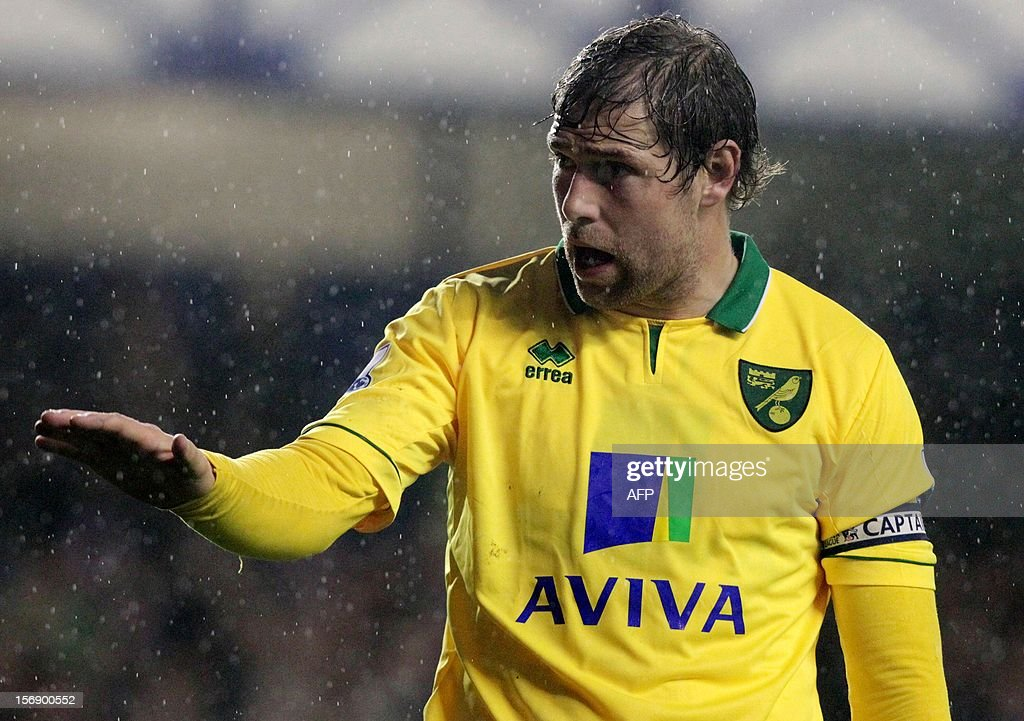 """Norwich City captain Grant Holt appeals to Everton fans after receiving abuse during the English Premiership League football match between Everton FC and Norwich City FC at the Goodison Park stadium in Liverpool, north west England on November 24, 2012. The match ended in a 1-1 draw. USE. No use with unauthorized audio, video, data, fixture lists, club/league logos or """"live"""" services. Online in-match use limited to 45 images, no video emulation. No use in betting, games or single club/league/player publications."""