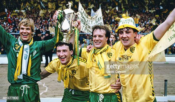 Norwich City defence from left to right Chris Woods Dave Watson Paul Haylock and Steve Bruce pose with the trophy after the 1985 League Cup Final win...