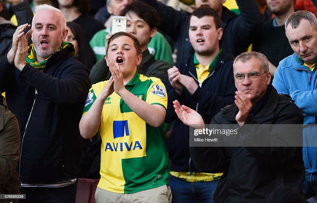 Norwich City fans applaud their team after the Barclays Premier League match between Arsenal and Norwich City at The Emirates Stadium on April 30, 2016 in London, England