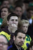 Norwich City fans look on during the English Premier League football match between Norwich City and Watford at Carrow Road in Norwich eastern England...