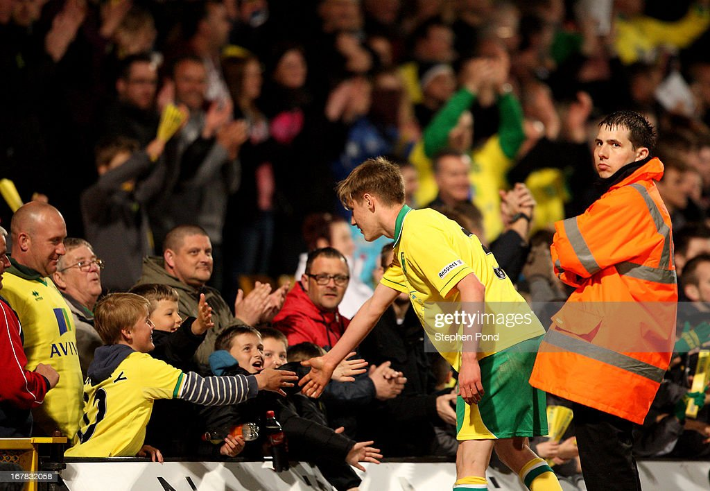 Norwich City fans shake the hand of Ben Wyatt during the FA Youth Cup Final First Leg match between Norwich City and Chelsea at Carrow Road on April 29, 2013 in Norwich, England.