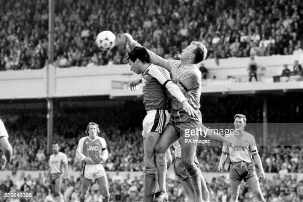 Norwich City goalkeeper Bryan Gunn punches clear from Arsenal's Alan Smith