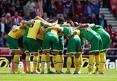 Norwich City huddle together ahead of the Barclays Premier League match between Sunderland and Norwich City at Stadium of Light on August 15 2015 in...