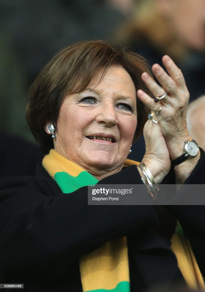 Norwich City co-owner <a gi-track='captionPersonalityLinkClicked' href=/galleries/search?phrase=Delia+Smith&family=editorial&specificpeople=216342 ng-click='$event.stopPropagation()'>Delia Smith</a> cheers on the stand prior to the Barclays Premier League match between Norwich City and West Ham United at Carrow Road on February 13, 2016 in Norwich, England.