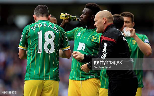 Norwich City Manager Alex Neil talks to his players during the Barclays Premier League match between West Ham United and Norwich City at the Boleyn...