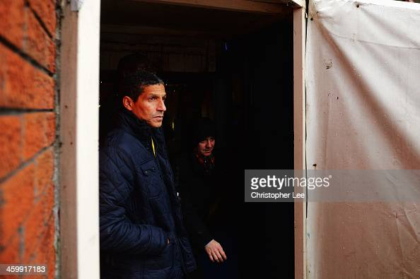Norwich City manager Chris Hughton looks out at the poor weather conditions before the Barclays Premier League match between Crystal Palace and...