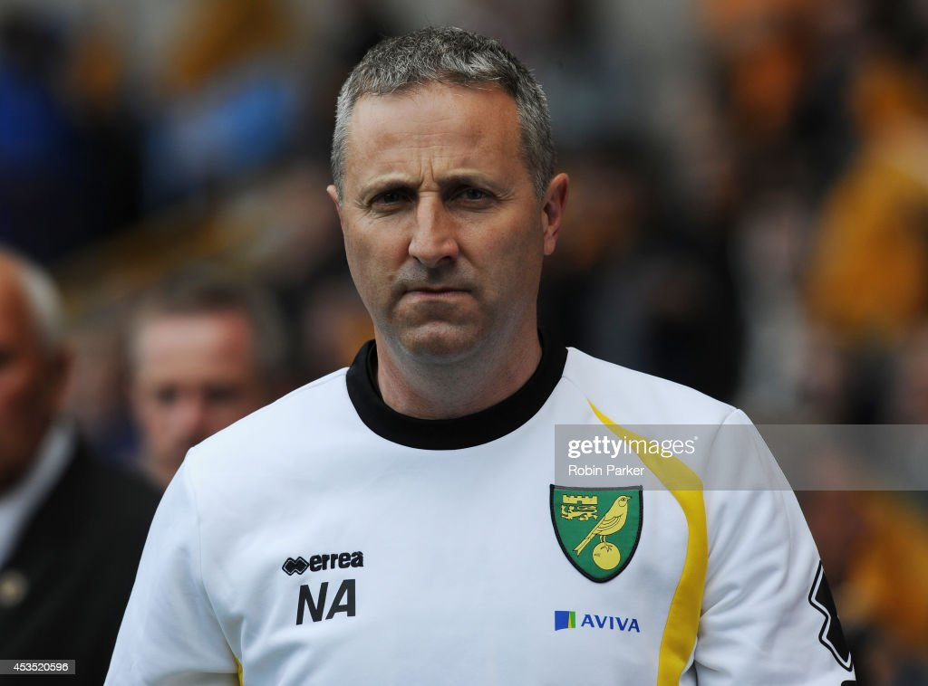Norwich City Manager <a gi-track='captionPersonalityLinkClicked' href=/galleries/search?phrase=Neil+Adams+-+Soccer+Player&family=editorial&specificpeople=12793124 ng-click='$event.stopPropagation()'>Neil Adams</a> during the Sky Bet Championship match between Wolverhampton Wanderers and Norwich City at the Molineux Stadium on August 10, 2014 in Wolverhampton, England.