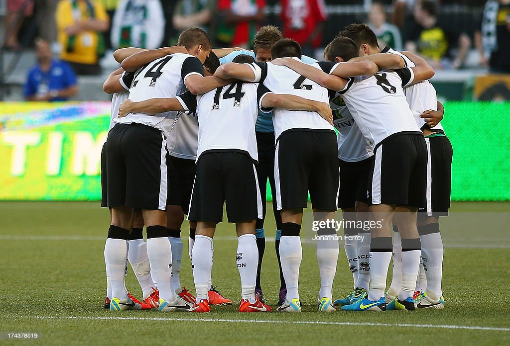 Norwich City players huddle before the match against the Portland Timbers on July 24, 2013 at Jeld-Wen Field in Portland, Oregon.
