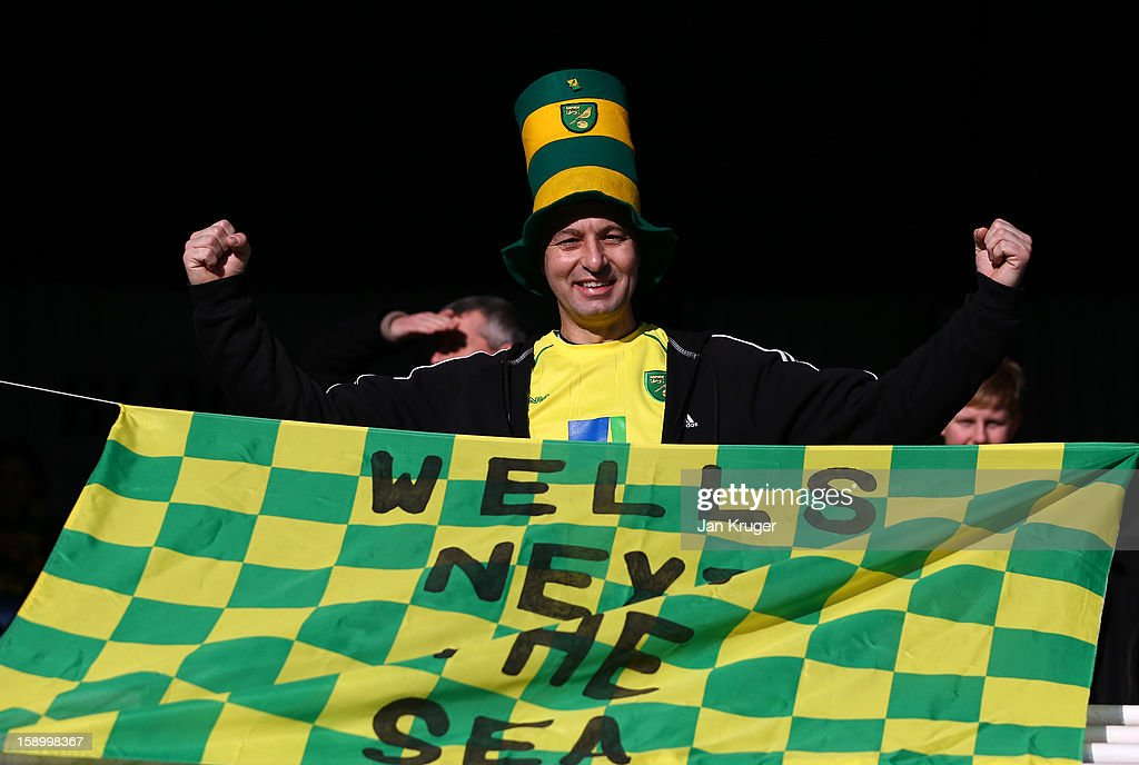 A Norwich City supporter shows his colours ahead of the FA Cup with Budweiser third round match between Peterborough United and Norwich City at London Road Stadium on January 5, 2013 in Peterborough, England.