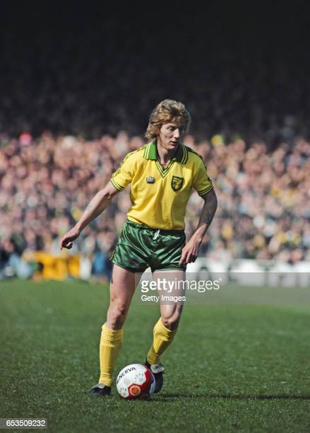 Norwich City winger Clive Woods in action with a Minerva Football with it's red slash during a First Division match circa 1980 in England