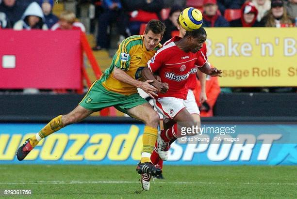 Norwich City's Adam Drury tussles with Charlton Athletic's Kevin Lisbie during the Barclays Premiership match at the Valley London Saturday November...