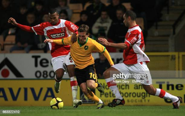 Norwich City's Arturo Lupoli battles for the ball with Charlton Athletic's Yassin Moutaouakil and Jonathan Fortune