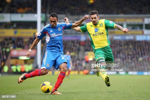 Norwich City's Bradley Johnson and Hull City's Ahmed Elmohamady battle for the ball