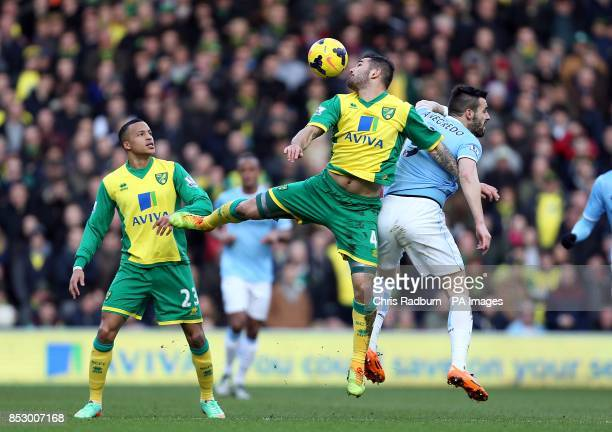 Norwich City's Bradley Johnson and Manchester City's Alvaro Negredo battle for the ball