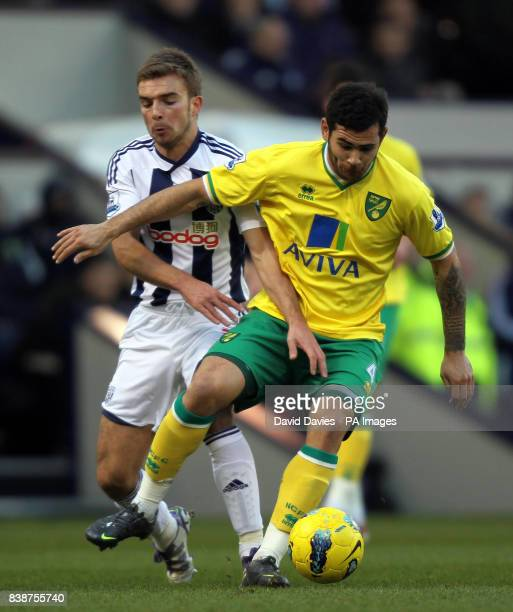 Norwich City's Bradley Johnson is tackled by West Bromwich Albion's James Morrison during the Barclays Premier League match at The Hawthorns West...