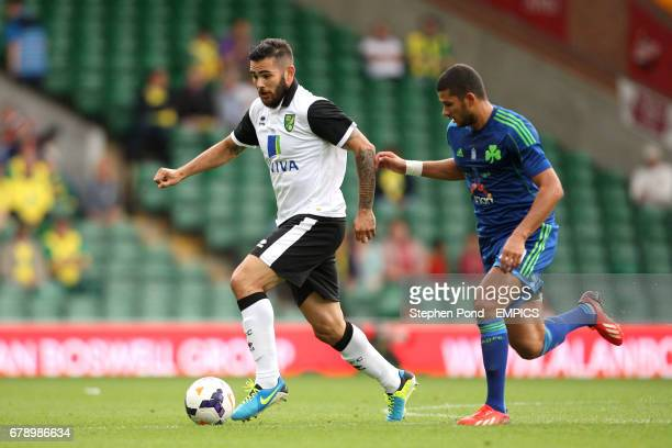 Norwich City's Bradley Johnson leaves behind Panathinaikos' Mehdi Abeid