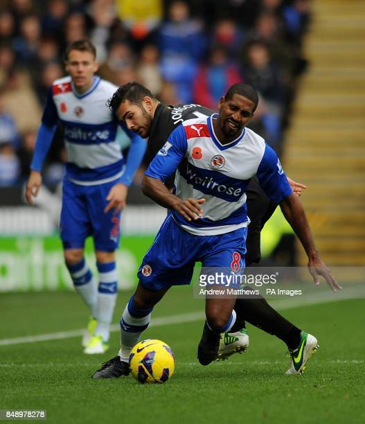 Norwich City's Bradley Johnson tackles Reading's Mikele Leigertwood during the Barclays Premier League match at the Madjeski Stadium Reading
