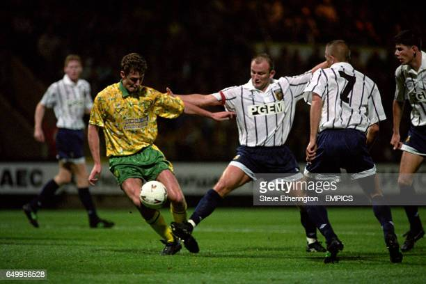 Norwich City's Chris Sutton and SBV Vitesse Arnhem's Theo Bos battle for the ball