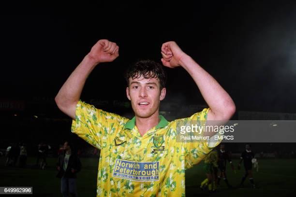 Norwich City's Chris Sutton celebrates after the game