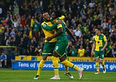 Norwich City's Congolese striker Dieumerci Mbokani celebrates with Norwich City's English midfielder Nathan Redmond after scoring their second goal...