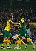 Norwich City's Congolese striker Dieumerci Mbokani celebrates with Norwich City's English midfielder Nathan Redmond and Norwich City's Portuguese...