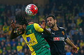 Norwich City's Congolese striker Dieumerci Mbokani vies with Watford's Uruguayan defender Miguel Britos during the English Premier League football...