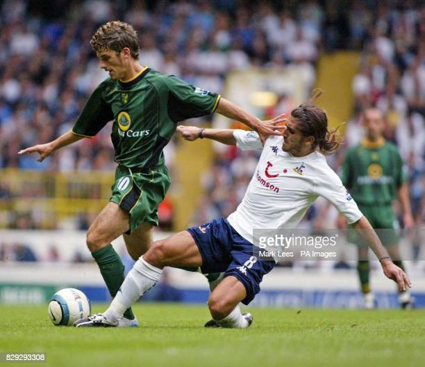 Norwich City's David Bentley is tackled by Tottenham Hotspur's Miguel Pedro Mendes during their Barclays Premiership match at White Hart Lane north...