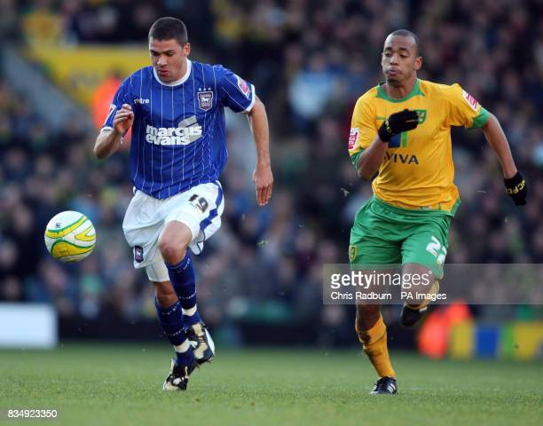 Norwich City's Elliot Omozusi chases Ipswich Town's Jon Walters during the CocaCola Championship match at Carrow Road Norwich