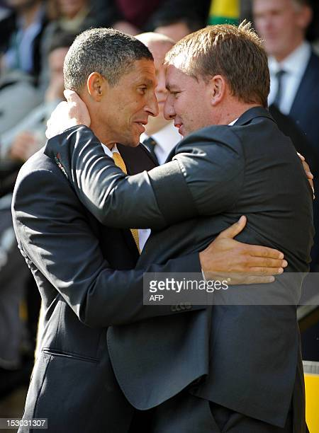Norwich City's English manager Chris Hughton greets Liverpool's Northern Irish manager Brendan Rodgers before the English Premier League football...