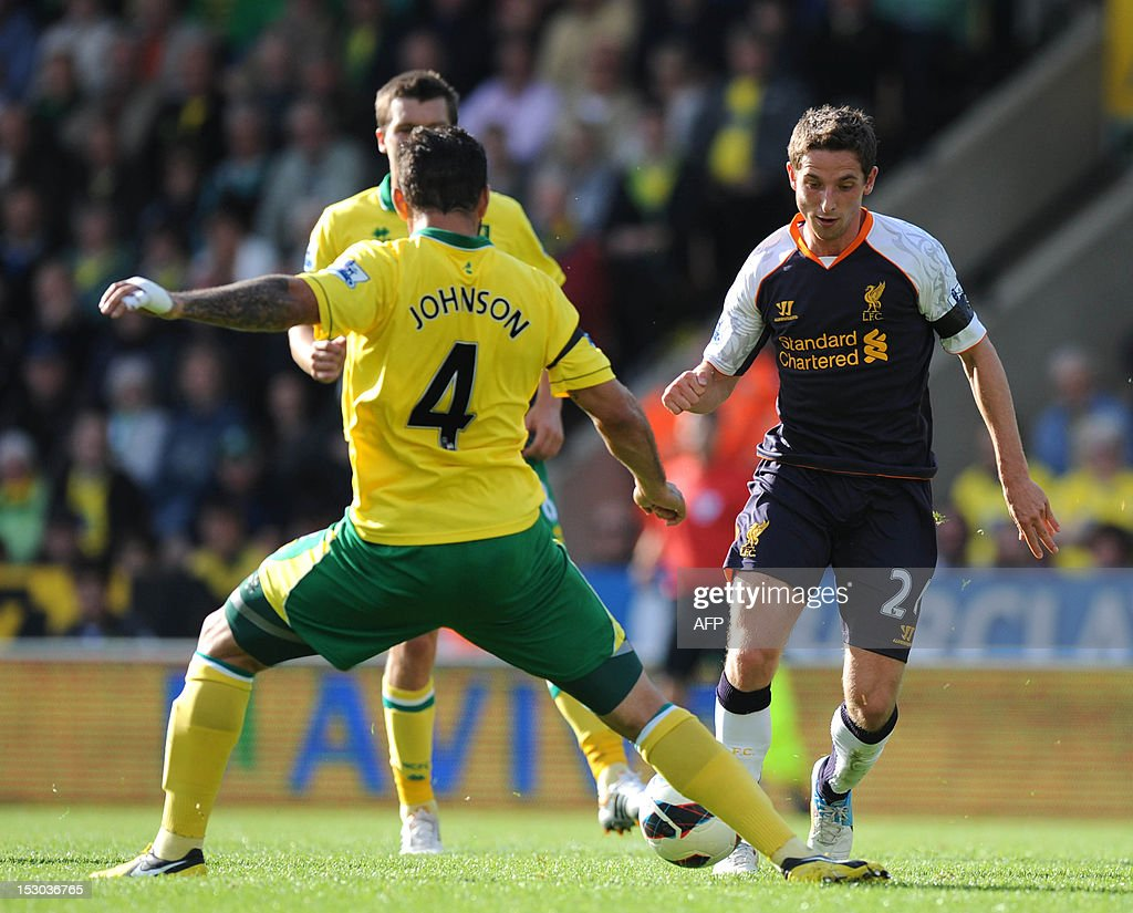 """Norwich City's English midfielder Bradley Johnson (L) vies with Liverpool's Welsh midfielder Joe Allen (R) during the English Premier League football match between Norwich City and Liverpool at Carrow Road stadium in Norwich, England on September 29, 2012. AFP PHOTO/OLLY GREENWOOD USE. No use with unauthorized audio, video, data, fixture lists, club/league logos or """"live"""" services. Online in-match use limited to 45 images, no video emulation. No use in betting, games or single club/league/player publications."""