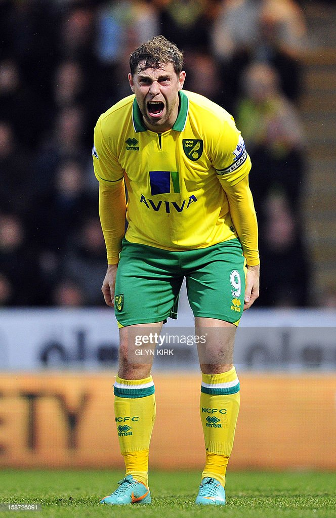 """Norwich City's English striker Grant Holt reacts during the English Premier League football match between Norwich City and Chelsea at Carrow Road stadium in Norwich, eastern England on December 26, 2012. USE. No use with unauthorized audio, video, data, fixture lists, club/league logos or """"live"""" services. Online in-match use limited to 45 images, no video emulation. No use in betting, games or single club/league/player publications."""