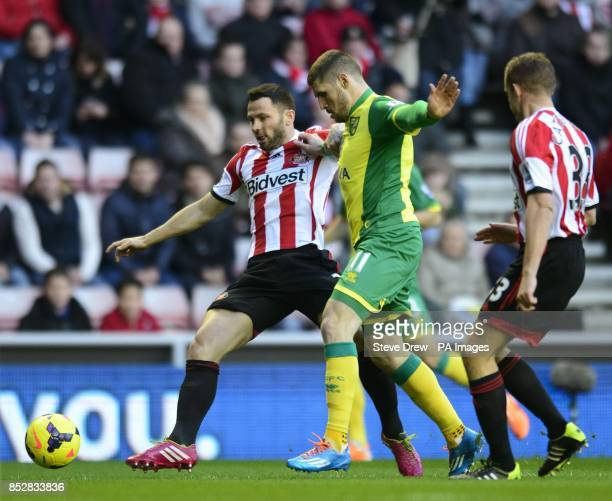 Norwich City's Gary Hooper comes under pressure from Sunderland's Lee Cattermole and Phil Bardsley during the Barclays Premier League match at The...