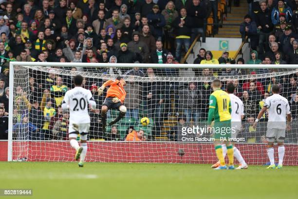 Norwich City's Gary Hooper scores their first goal of the game past Swansea City goalkeeper Michel Vorm