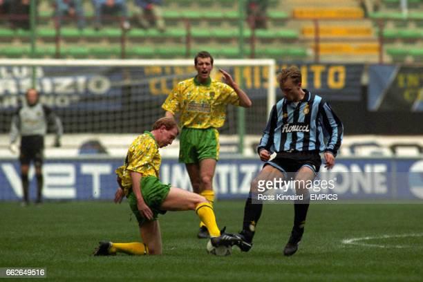 Norwich City's Gary Megson tackles Inter Milan's Dennis Bergkamp Chris Sutton looks on