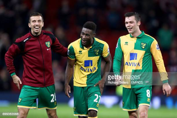 Norwich City's Gary O'Neil Alexander Tettey and Jonny Howson celebrate victory after the final whistle