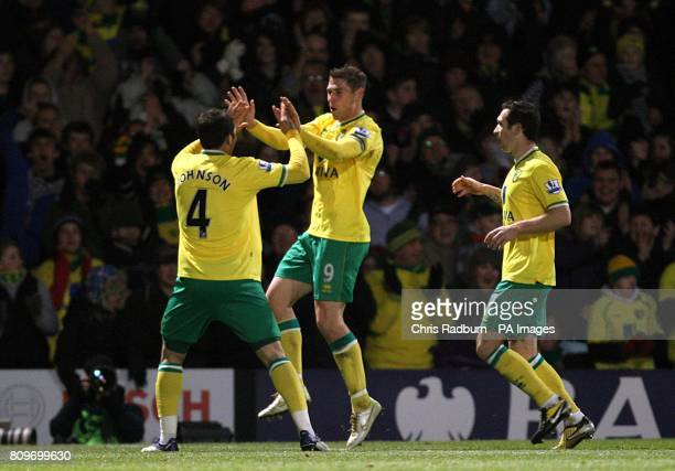 Norwich City's Grant Holt celebrates scoring his side's fourth goal of the game with teammate Bradley Johnson