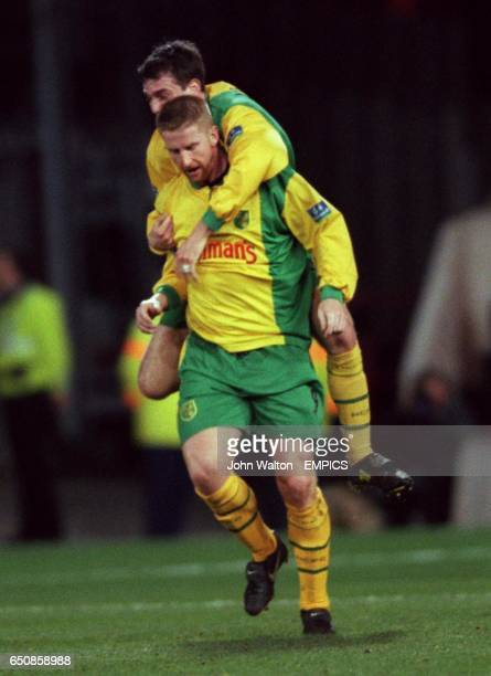 Norwich City's Iwan Roberts is congratulated on scoring by Chris Llewellyn