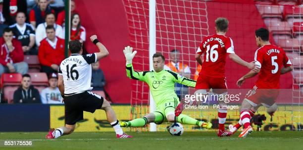 Norwich City's Johan Elmander scores past Southampton's Artur Boruc during the Barclays Premier League match at St Marys Southampton