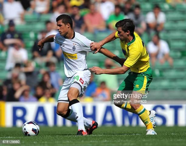 Norwich City's Jonny Howson and Borussia Monchengladbach's Granit Xkaka