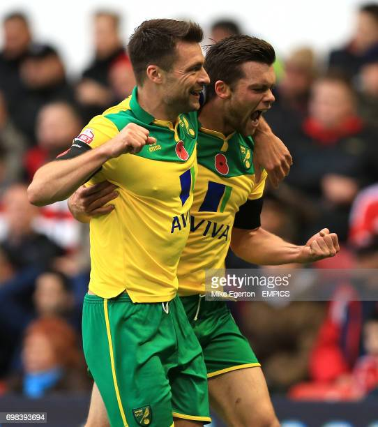 Norwich City's Jonny Howson and Russell Martin celebrate after the first goal