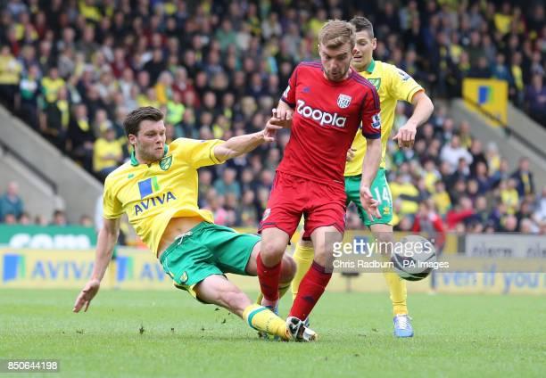 Norwich City's Jonny Howson challenges for the bal against West Bromwich Albion's James Morrison during the Barclays Premier League match at Carrow...